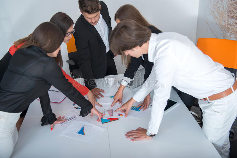 Group of business colleagues listening to a businessman during a meeting. stock images