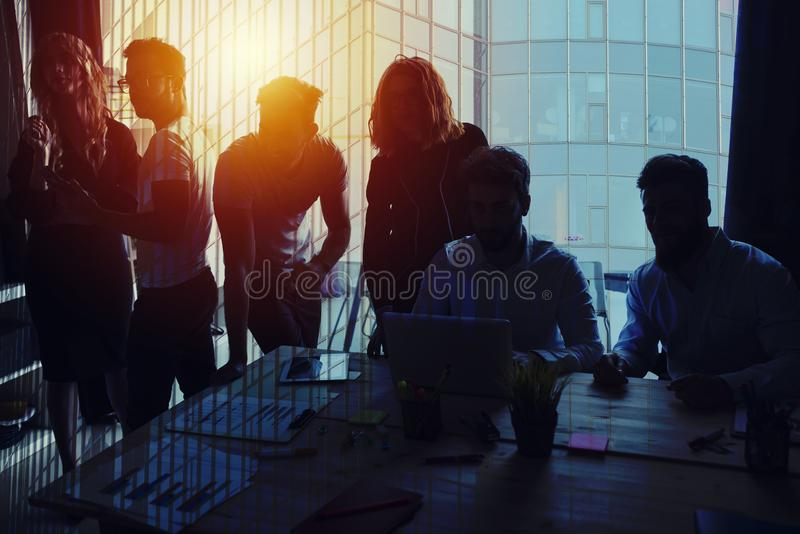 Group of business partner looking for the future. Concept of corporate and startup. Group of business partner in office looking for the future. Concept of stock photo