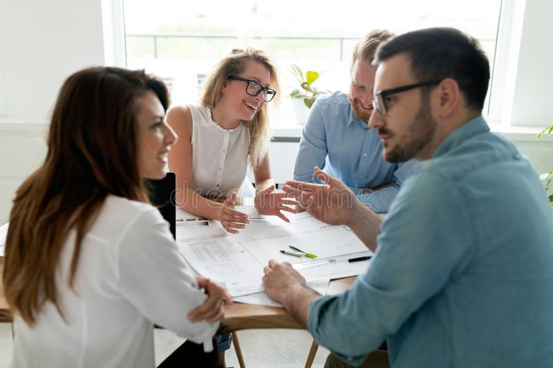 Group of business partners discussing ideas and planning work in office royalty free stock photos