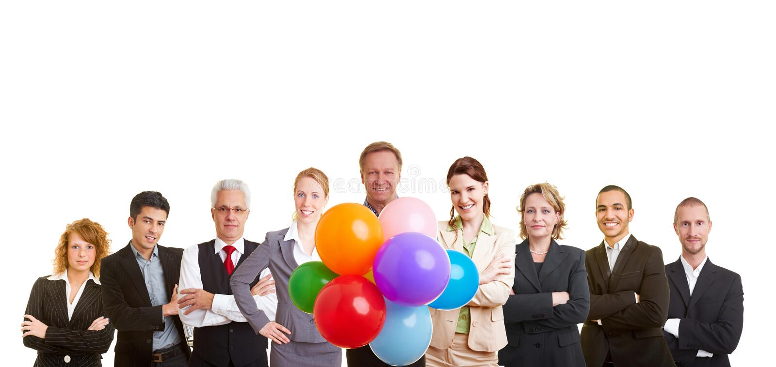 Group of business people. Celebrating with many balloons royalty free stock photography