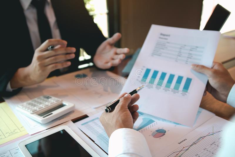 Group of business people analysis summary graph reports of business operating expenses and work data about the company`s financia. L statements stock image