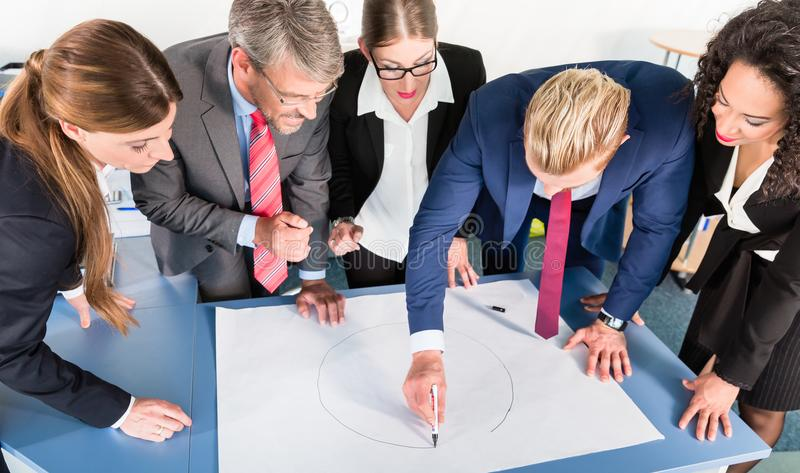 Group of business people analyzing data stock photo