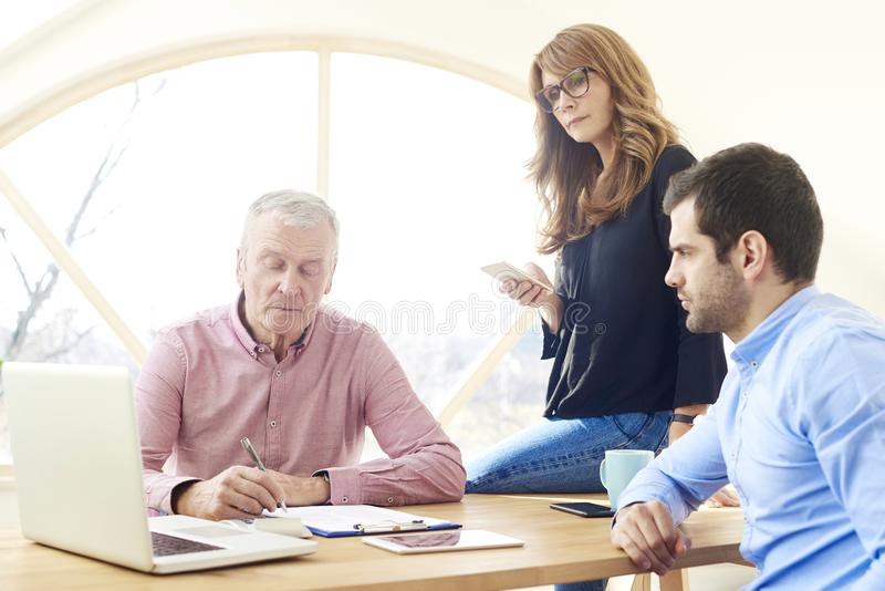 Group of business people analyzing financial data stock photo