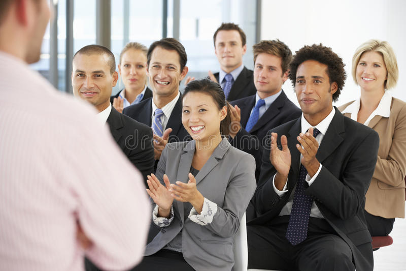 Group Of Business People Applauding Speaker At The End Of A Presentation stock photos