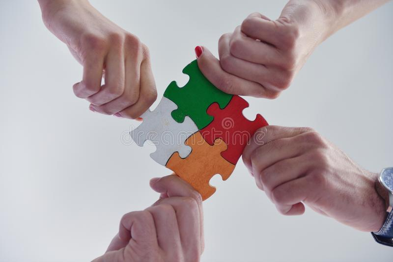 Download Group Of Business People Assembling Jigsaw Puzzle Stock Photo - Image: 33600924