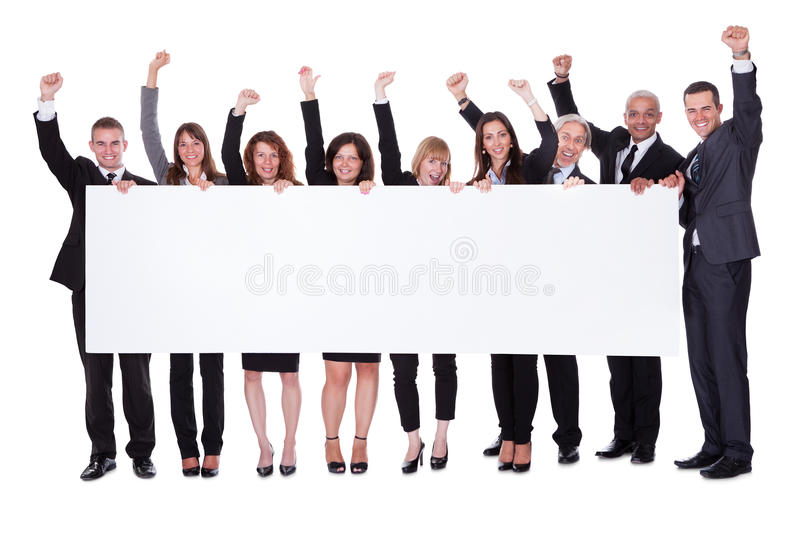 Group of business people with a blank banner royalty free stock images