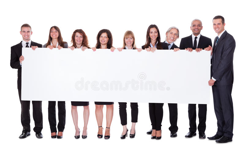 Group of business people with a blank banner royalty free stock photography