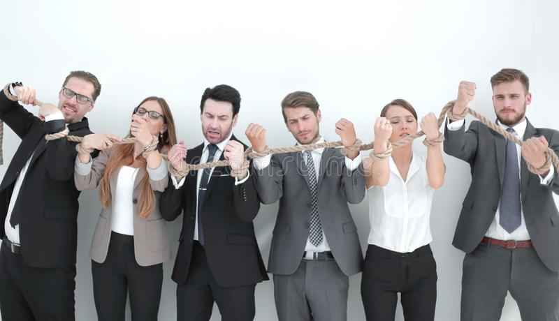 Group of business people breaking a strong rope. Photo with copy space royalty free stock photo