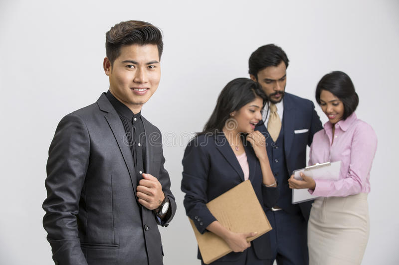 Group of business people with businessman leader stock photos