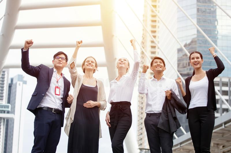 Group Of Business People Celebrating  of successful raised fist in the urban city on building background at workplace outdoors. stock images