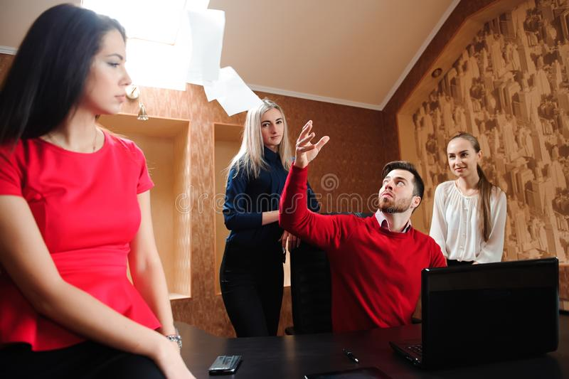 Group of business people celebrating by throwing their business papers in the air. royalty free stock photos