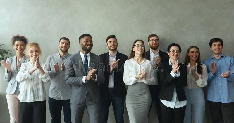 Group of business people clapping hands to congratulate boss royalty free stock image