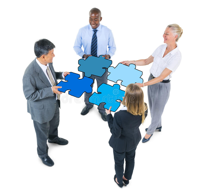 Group of Business People Connecting Jigsaw Puzzles.  royalty free stock photography