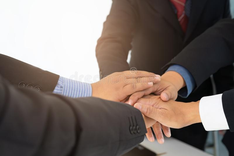 Group of business people coordinating hands after successful projects at meeting. royalty free stock photography