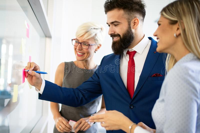 Group of business people discussing, brainstorming in office. Concentrated at work. Concentrated at work. Group of business people discussing, brainstorming in royalty free stock images