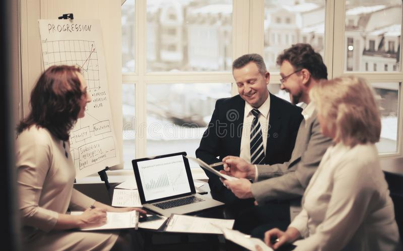 Group of business people discussing an important document. Office life stock photography