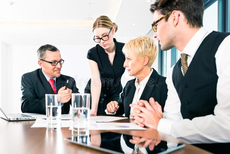 Group of business people working in office royalty free stock photo