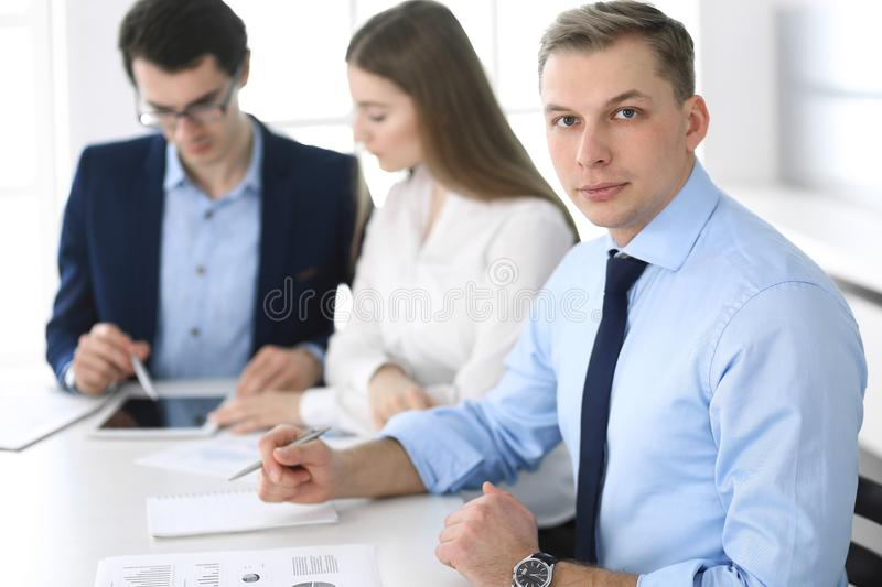 Group of business people discussing questions at meeting in modern office. Headshot of businessman at negotiation stock photos