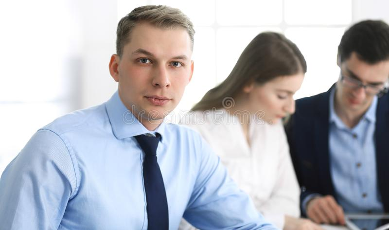 Group of business people discussing questions at meeting in modern office. Headshot of businessman at negotiation royalty free stock images