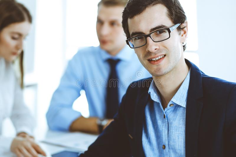 Group of business people discussing questions at meeting in modern office. Headshot of businessman at negotiation royalty free stock image