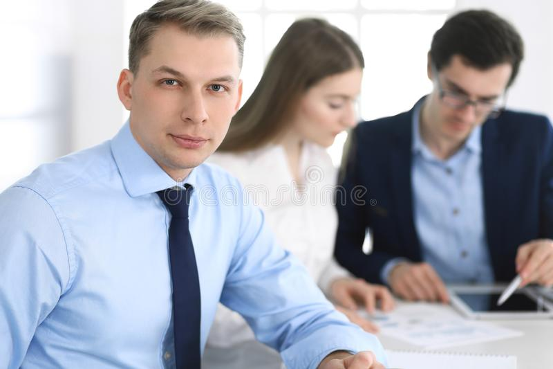 Group of business people discussing questions at meeting in modern office. Headshot of businessman at negotiation royalty free stock photos