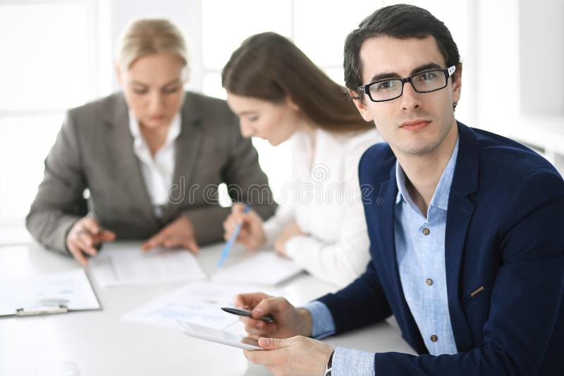 Group of business people discussing questions at meeting in modern office. Headshot of businessman at negotiation royalty free stock photography