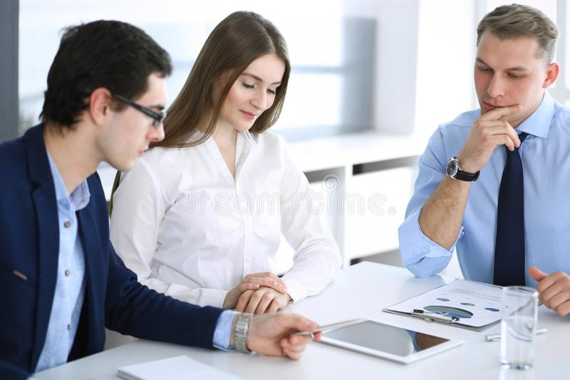 Group of business people discussing questions at meeting in modern office. Managers at negotiation or brainstorm royalty free stock images