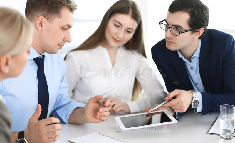 Group of business people discussing questions at meeting in modern office. Managers at negotiation or brainstorm royalty free stock photos