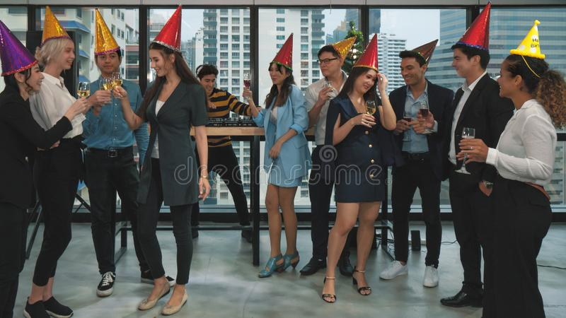 Group of business people enjoying party and drinking champagne and wine together to celebrate company success and new year event royalty free stock images