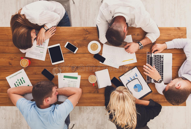 Group of business people exhausted sleep in office, top view stock image