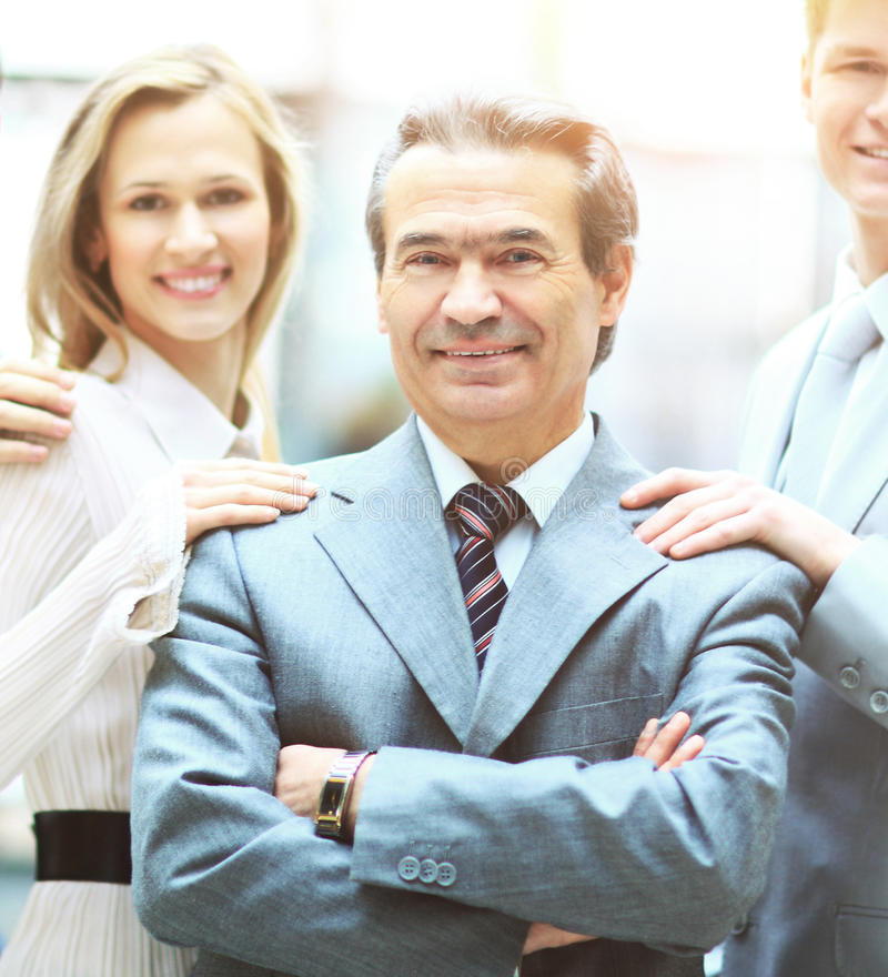 Group of business people facing each other with the leader a businessman in the foreground stock photography