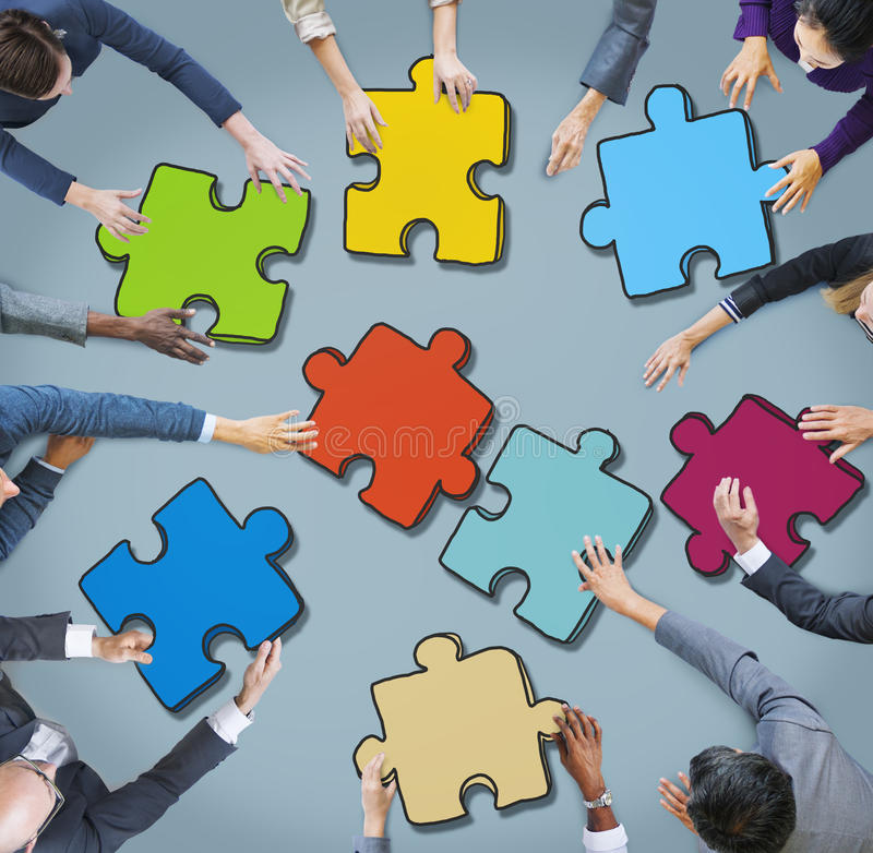 Group of Business People Forming Jigsaw Puzzle.  royalty free stock images