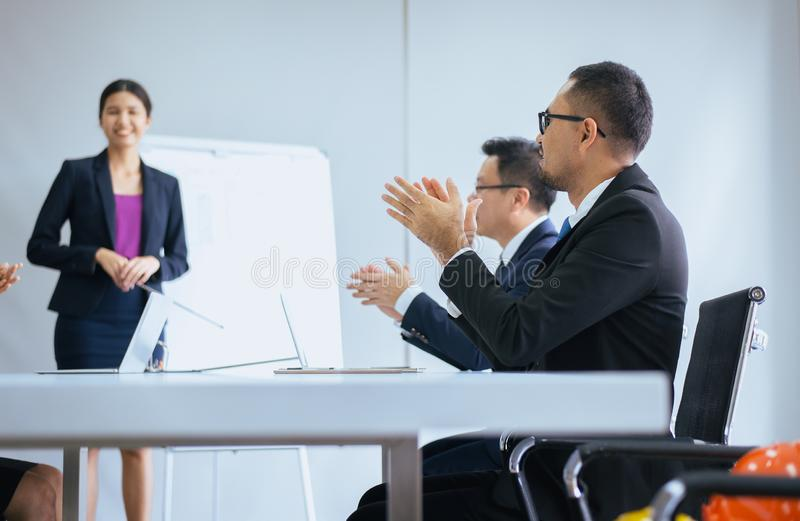 Group of business people hands clapping after meeting,Success presentation and coaching seminar in room stock image