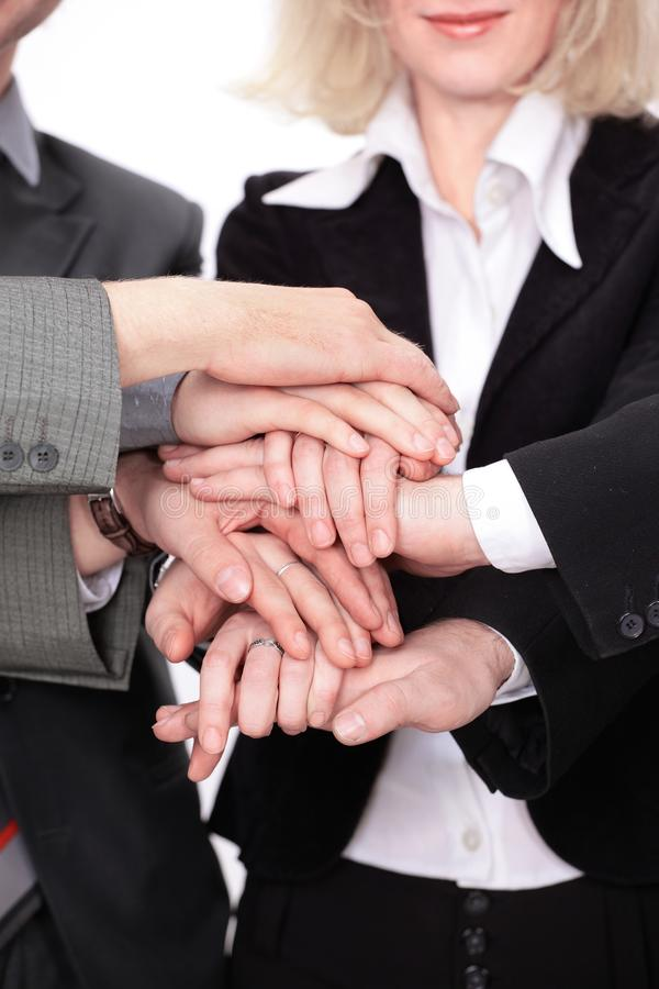 Group of business people with hands clasped together. stock photography