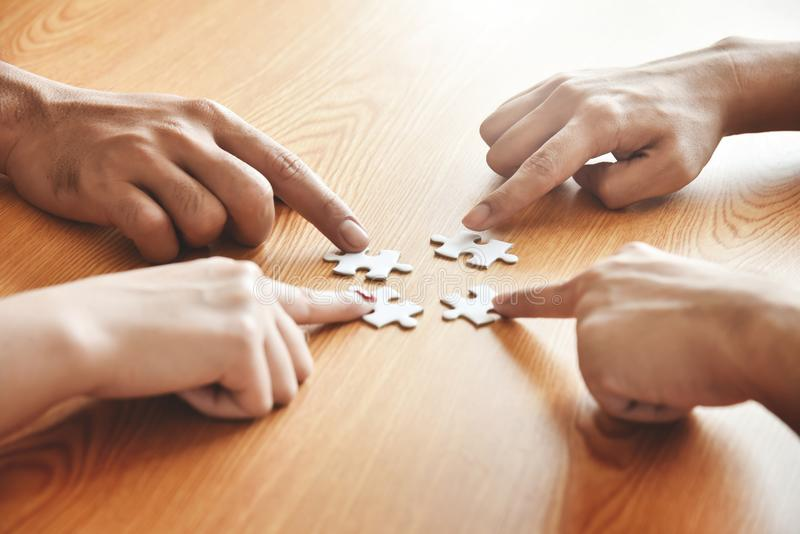 Group of Business people hands are holding jigsaw puzzle. stock photography