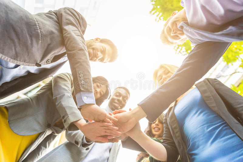 Group of business people with hands on stack stock photos