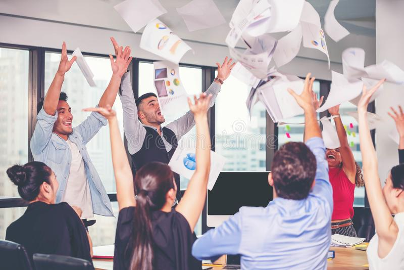 Group of business people happy with job successfully done. Business team trow paper up as happiness sign of victory.  stock photography
