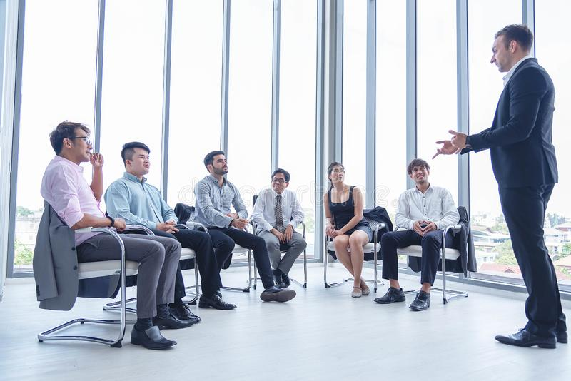 Group of business people having a meeting for new project planning. Manager standing and lead the annual sale meeting stock photography