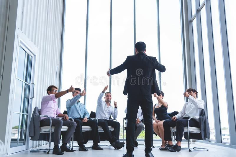 Group of business people having a meeting for new project planning. Manager standing and lead the annual sale meeting stock images