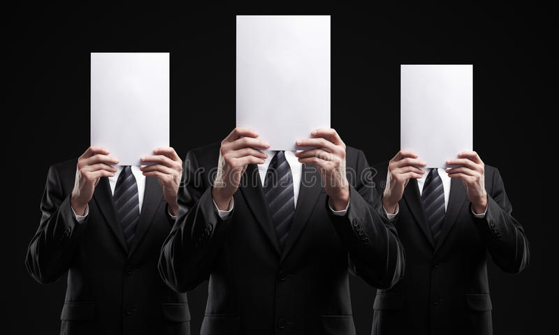 Group of business people holding a blank signs stock photo