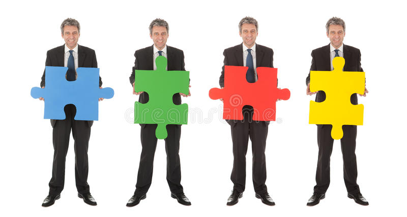 Group Of Business People Holding Jigsaw Puzzle Royalty Free Stock Images