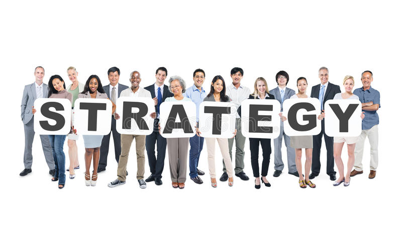 Group Of Business People Holding Word Strategy. Multi-ethnic group of business and casual people holding cardboards forming strategy stock photos