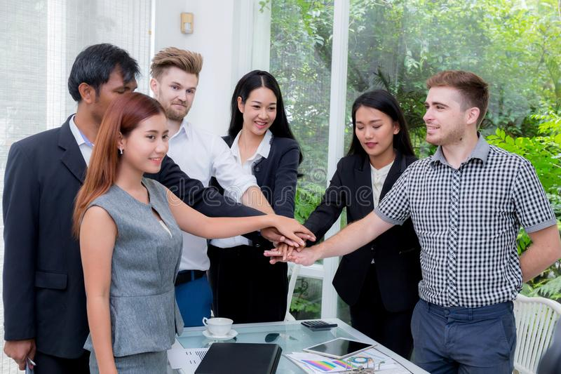 Group of business people join the hand or group teamwork concept. royalty free stock image