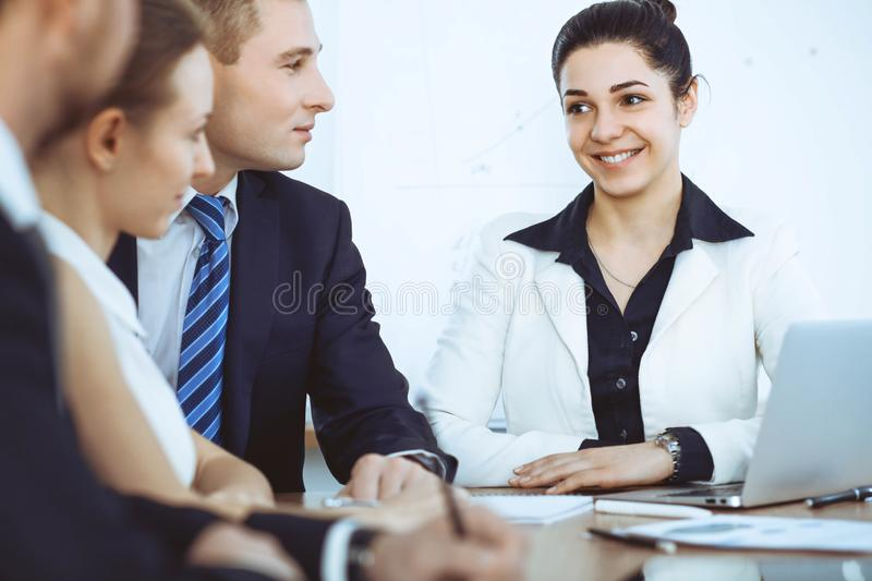 Group of business people and lawyers discussing contract papers at meeting stock image