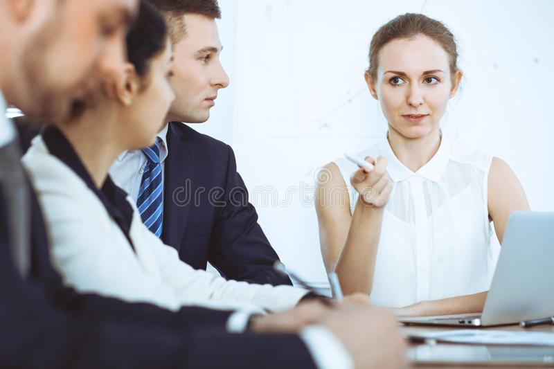 Group of business people and lawyers discussing contract papers at meeting royalty free stock photo