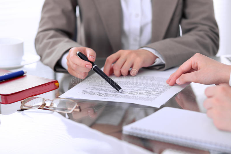 Group of business people and lawyers discussing contract papers sitting at the table, close up royalty free stock images