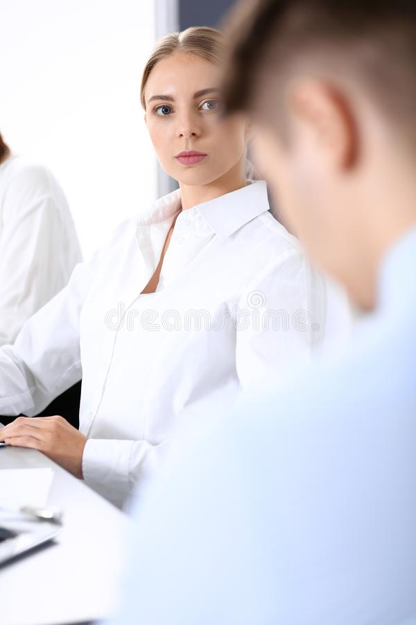 Group of business people or lawyers discussing terms of transaction in office. Colleagues working all together. Focus a royalty free stock photography