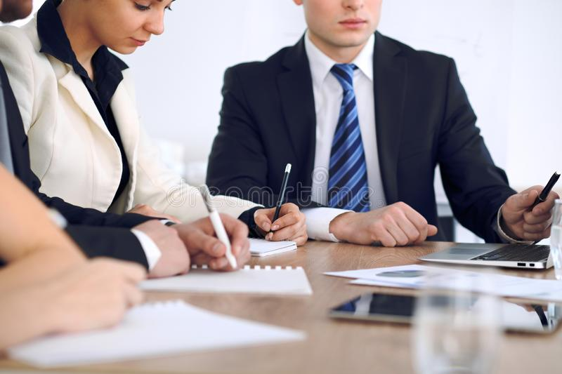 Group of business people or lawyers at meeting, hands close-up stock photo