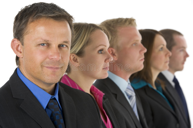 Group Of Business People In A Line Looking stock image