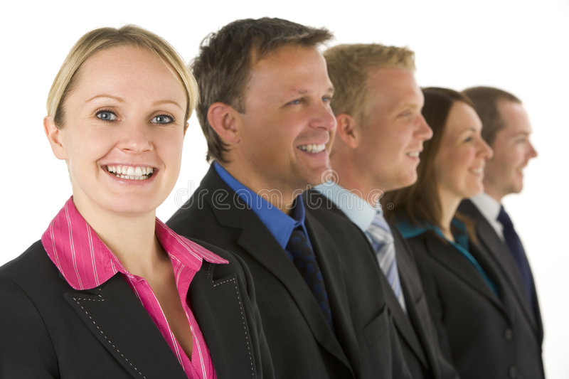 Group Of Business People In A Line Smiling stock photography